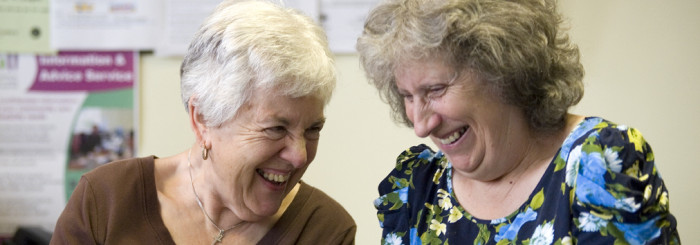 Older women, 60s-70s chatting, laughing